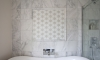 Cool, calming bathroom with statement star mosaic wall —Lower Beeding