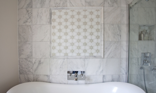 Image: Cool, calming bathroom with statement star mosaic wall