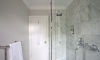 Elegant, marble-tiled shower room —Lower Beeding