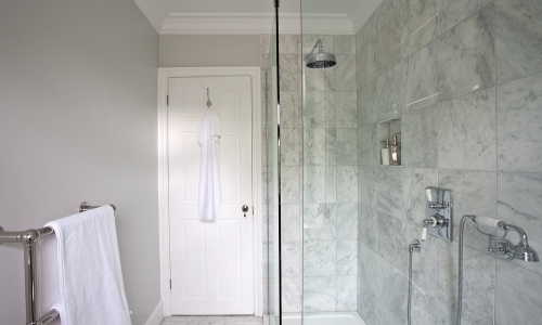 Image: Elegant, marble-tiled shower room