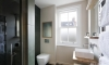 Hexagonal black tiled, slate bathroom —Hove