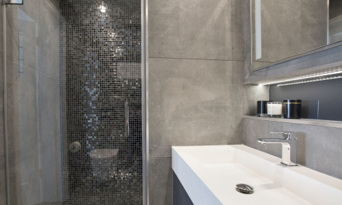 Image: Double basin bespoke vanity with mosaiced wetroom