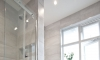 Soft grey family bathroom with recessing —Hove