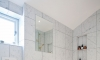 Carrara marble family bathroom with gold finishes —Brighton