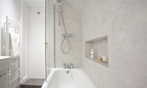 Image: Compact, neutral loft bathroom