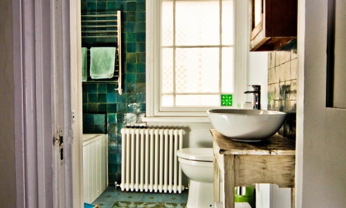 Image: Vibrant family bathroom with distressed-look detail