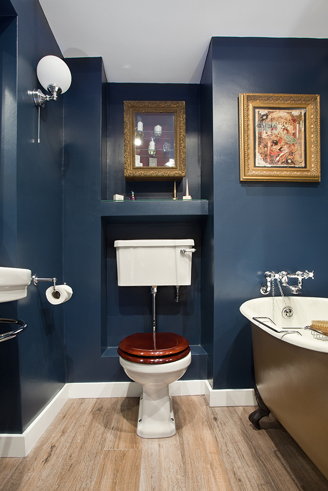 Glamorous Bathroom Boudoir With Rich Blue Walls And Gold