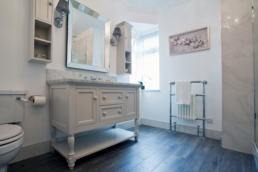 Large main bathroom with freestanding bath —Hove | The Brighton ...