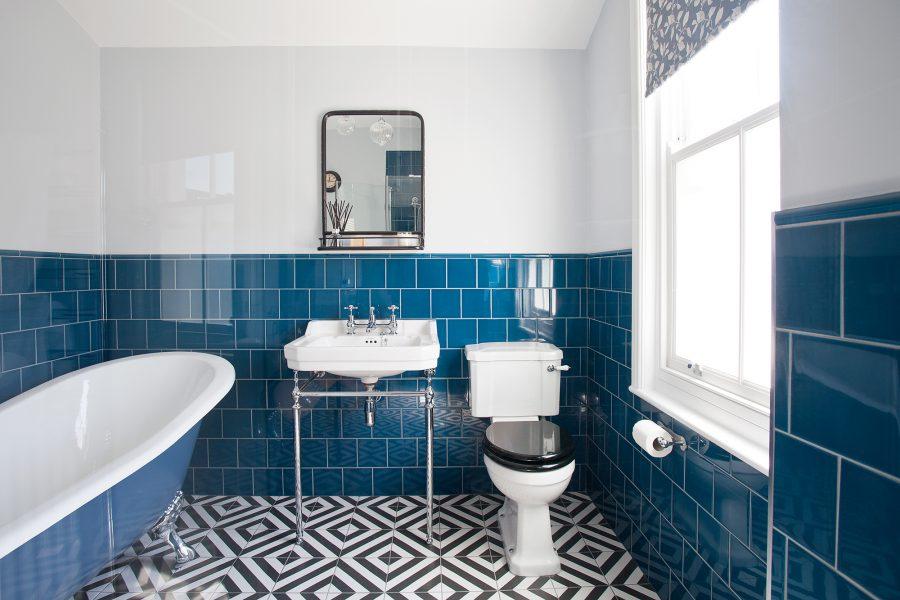 blue tiled main bathroom with slipper bath and geometric flooring hove the brighton bathroom. Black Bedroom Furniture Sets. Home Design Ideas