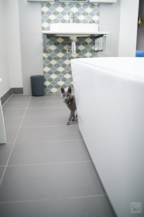 Image: Master ensuite with soft blue and green feature tiling and bespoke wardrobes